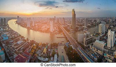 Sunset skyline over Bangkok city panorama