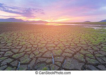 Sunset skyline over dry crack land
