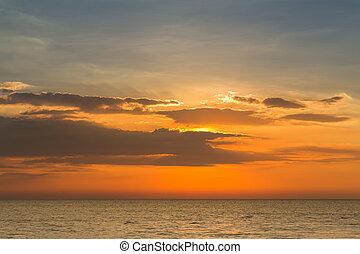 Sunset skyline over seacoast