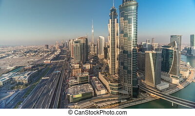 Sunset skyline with modern skyscrapers and traffic on sheikh...