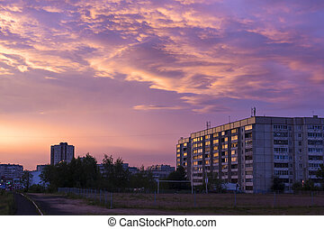 Sunset skyscape over city
