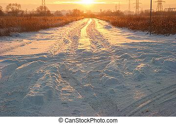 Sunset snowy road