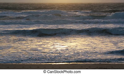 Sunset storm waves crashing