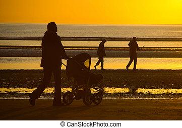 Sunset - Stroller on sunset beach