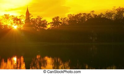 Sunset through Hazy Light over a Pond in Thailand -...