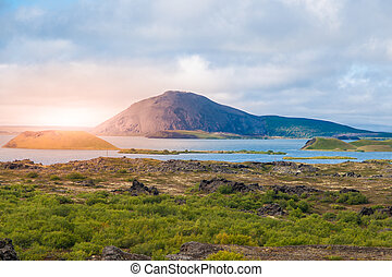 Sunset time in volcanic landscape at Myvatn Lake, aka Lake of mosquitos, northern Iceland