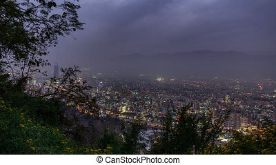 Sunset time lapse over Santiago de Chile city with sky...