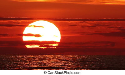 Sunset timelapse - An iconic sunset over sea with a great,...