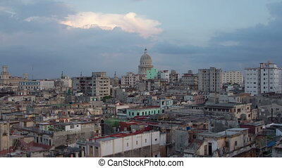 sunset timelapse as day turns to night, of the havana skyline and capitolio building, cuba
