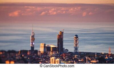 Sunset timelapse Batumi cityscape pan down