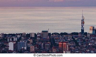 Sunset timelapse Batumi cityscape pan right