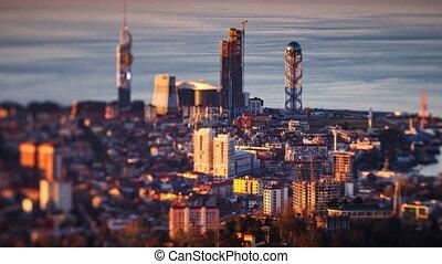 Sunset timelapse Batumi cityscape pan up - 4K Sunset...