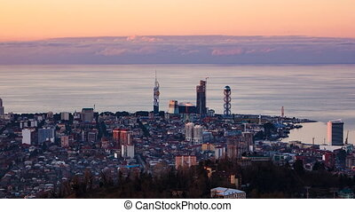 Sunset timelapse Batumi cityscape zoom in