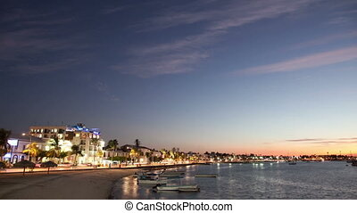sunset timelapse in the coastal town of la paz, baja...