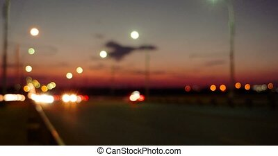 Sunset traffic on motorway with blurred lights