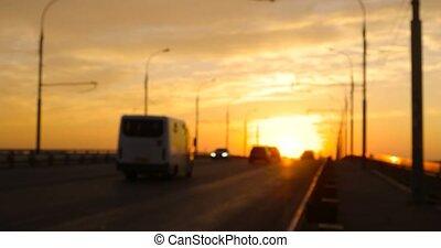 Sunset traffic on overpass defocused.