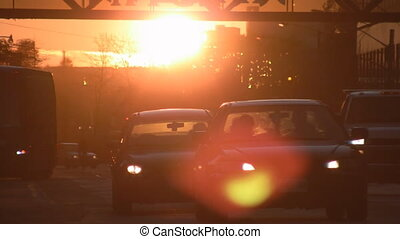 Sunset traffic. - Sun going down with traffic in the...