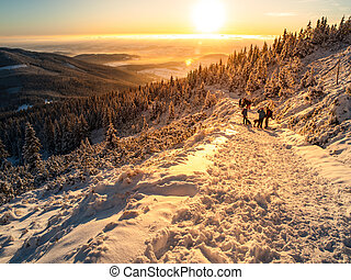 Sunset trip in winter mountains