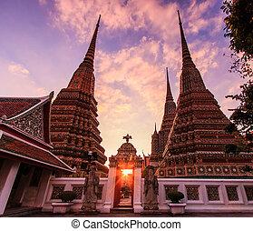 Sunset twilight Buddhist temple, Wat Pho in Bangkok ,Asia...