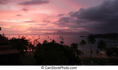 Sunset behind Moorea Island Mountains seen from Tahiti, in...