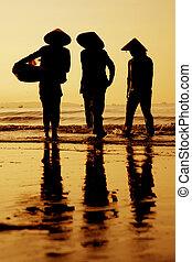 Sunset Vietnam - Three fisherwomen on the beach in Vietnam...