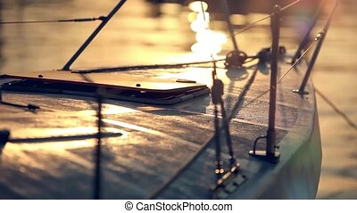 sunset view from nose of yacht and sun reflected in water like blurred bokeh