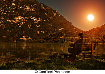 Sunset view - man at the lake