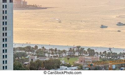 Sunset view of beach on JBR timelapse - Jumeirah Beach Residence in Dubai, United Arab Emirates