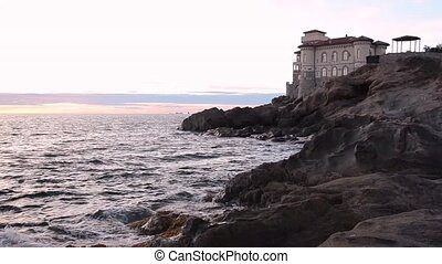 sunset view of Castello del Boccale - sunset view of sea and...