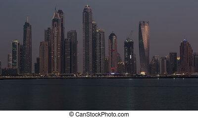 sunset view of Dubai skyscraper
