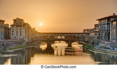 Sunset view of Florence Ponte Vecchio over Arno River in...