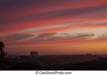 Sunset view of San Diego, California and red cloudy sky