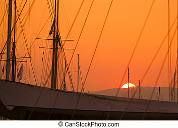 sunset view of the sailboats in port