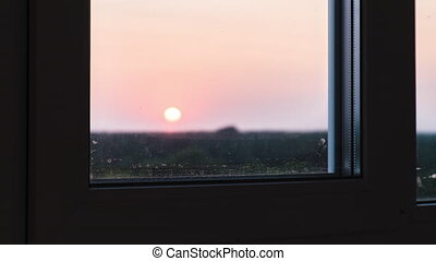 Sunset view through the Window. Bright Yellow Sun Moves over...
