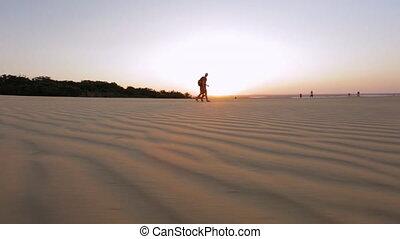 Sunset Walk On Sand Dunes, Qld Island