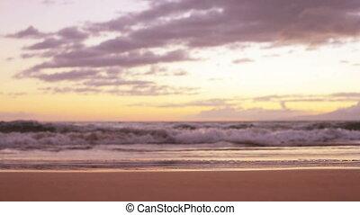 Sunset waves on the beach