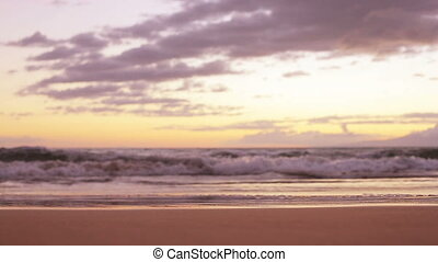 Sunset waves on the beach - Waves washing up on the beach at...