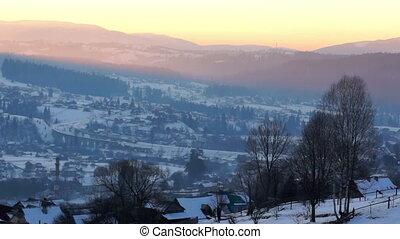 Sunset winter mountain village landscape