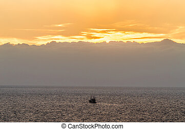 Sunset With A Beautiful Orange Sky And A Fishing Boat Colliding In The Photo On Las Americas Beach. April 11, 2019. Santa Cruz De Tenerife Spain Africa. Travel Tourism Street Photography.