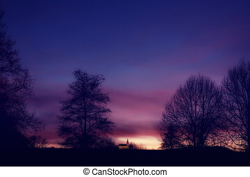 Sunset with black silhouette and dramatic sky