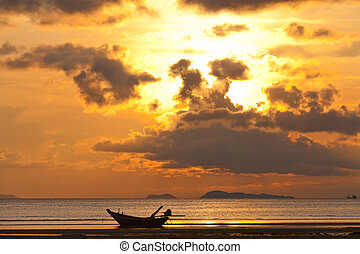 Sunset with boat in the sea
