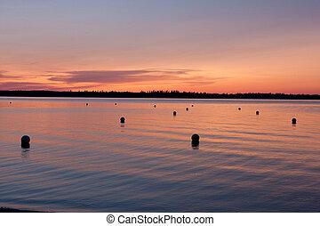 A warm glowing sunset on a lake.