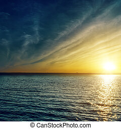 sunset with clouds over water