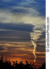 Sunset with contrail