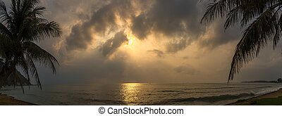 Sunset with dramatic cloud over sea