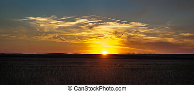 sunset with dramatic sky over land