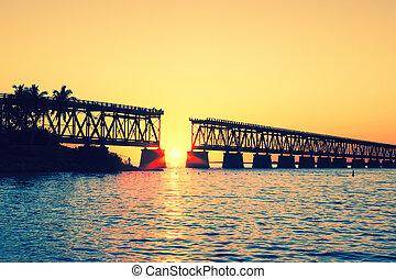 Sunset with famous broken bridge