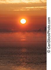 sunset with fog