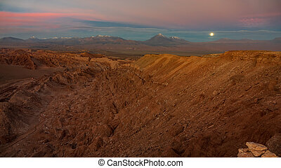 Sunset with full moon rising over Licancabur volcano