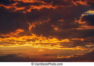 Sunset with glowing clouds in the sky